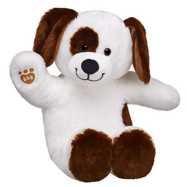 brown and white coloured dog stuffed animal sitting and waiving