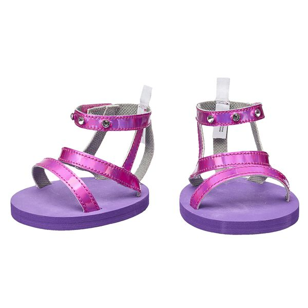 Your furry friend's paws will fit perfectly in this chic pair of sandals. These pink sandals have studded gems on the top strap for some extra flair.