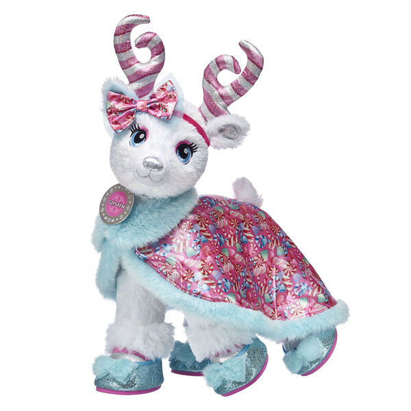 Just in from the North Pole! Candy Cane Glisten will be able to soar all season long with this magical stuffed animal gift set! With candy cane antlers, sparkly soft fur and sweet candy-inspired fashions, this lovable reindeer stuffed animal will fly straight from the Candy Cane Forest and into their heart. No matter where their imagination takes them this winter, this cuddly gift set is an unforgettable way to make memories!