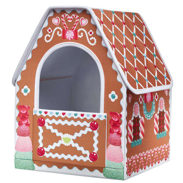 Give your furry friend a house that's sweeter than gumdrops! This cute brown gingerbread house has decorative icing and gum drops printed all over it and has an opening for your furry friend to look out of. It's an adorable way to transport your furry friend this Christmas season!