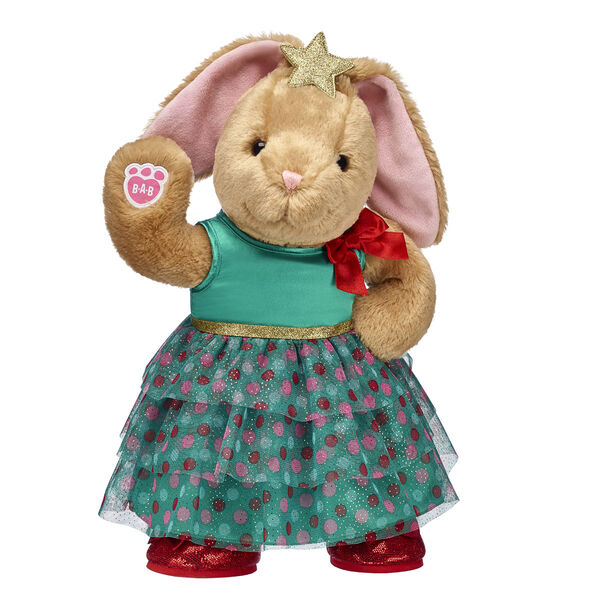 Pawlette's rockin' around the Christmas tree! This cute bunny stuffed animal looks wonderful in her stunning Christmas tree dress, which comes complete with a star headband and sparkly red flats. This cuddly bunny gift set would look so cute underneath the tree on Christmas morning!