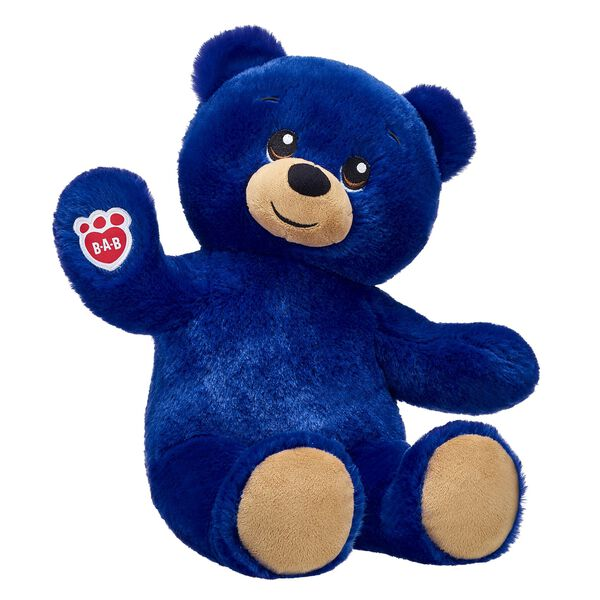Lil' Blue Bear is ready to stuff your days with fun! This huggable lil' bear has bright blue fur and toasty brown paw pads. Add this bright blue teddy bear to your collection and have fun dressing it in your favourite outfits and accessories!