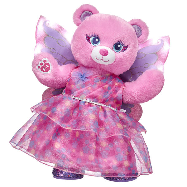 """Open the door to a fantasy world of fun with this enchanting gift set! This pretty-in-pink gift set features the adorable Fairy Bear is all set to spread magical fairy cheer.  <p>Price includes:</p>  <ul>     <li>Fairy Bear</li>     <li>Pink Fairy Gown </li>     <li>Light-Up Fairy Wings</li>    <li>Purple Sequin Flats</li> </ul>"""