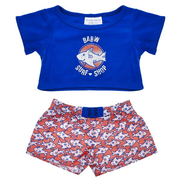 The Build-A-Bear Workshop Surf Shop has everything your furry friend needs to hit the beach! This two-piece swim set features a blue T-shirt with a shark logo in the center. The matching orange swim trunks feature a ferociously fun shark pattern. Get ready to ride some waves with the Build-A-Bear Workshop Surf Shop!