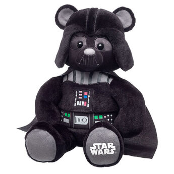 Never underestimate the power of the dark side. Our exclusive Darth  Vader™ Bear comes with his signature helmet, cape and control chest  panel, permanently attached. Complete your destiny and add Darth Vader's  iconic Breathing Sound, Imperial March Song and his red Lightsaber. © & ™ Lucasfilm Ltd.