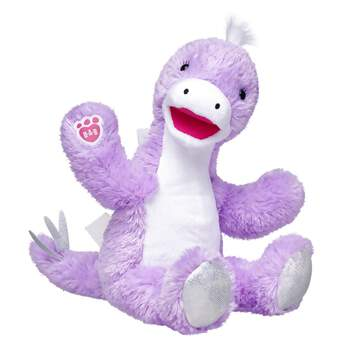 """Did you know Stegosaurus means """"covered lizard?"""" This Stegosaurus Stuffed Animal lives true to it's name with soft plates running down its spine - similar to the bony plates on a real Stegosaurus! The soft, light purple, plant eating Stegosaurus Stuffed Animal also has a tail with soft spikes and the B-A-B logo on its paw."""