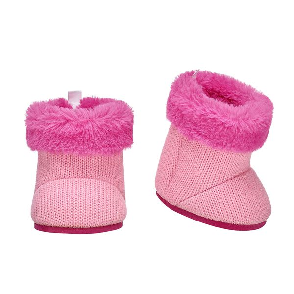 Add a pop of colour to your furry friend's winter look! These cute knit boots are a pretty pink colour and have a faux fur lining.