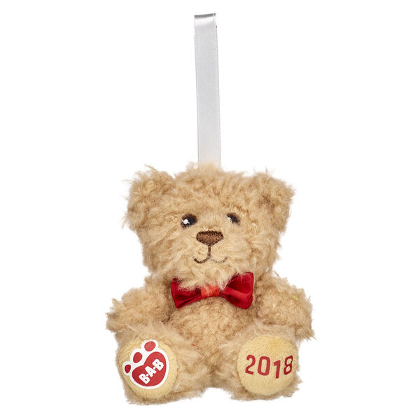 Give bear hugs this Christmas with our adorable 2018 commemorative Christmas ornament. This cute lil' teddy will look sweet as can be hanging on anyone's Christmas tree. The year 2018 on the paw pad provides a personal touch.