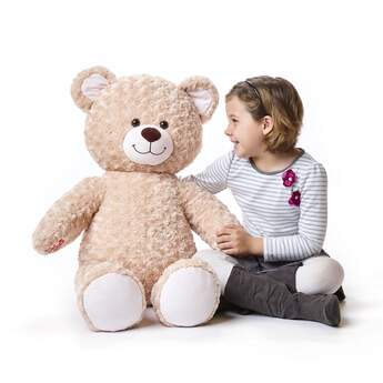 15ab9b5a6b6 Take fun to the next level with this Jumbo-sized Happy Hugs brown teddy bear  ...