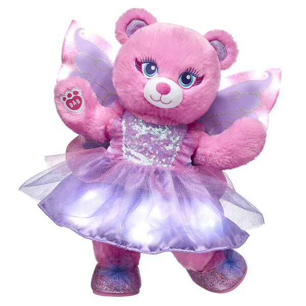 Open the door to a fantasy world of fun with this enchanting gift set! With a twinkling light-up dress and pretty light-up wings, Fairy Bear is all set to spread magical fairy cheer.  <p>Price includes:</p>  <ul>    <li>Fairy Bear</li>     <li>Light-Up Fairy Princess Dress</li>    <li>Light-Up Fairy Wings</li>    <li>Fairy Sparkle Flats</li> </ul>