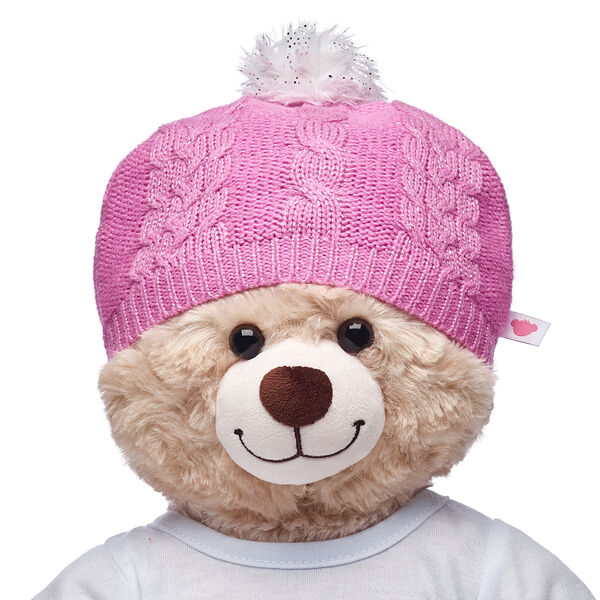 Keep your furry friend's ears warm with this FURbulous pink beanie. The fuzzy white pom on top of this beanie hat has sparkles on it!