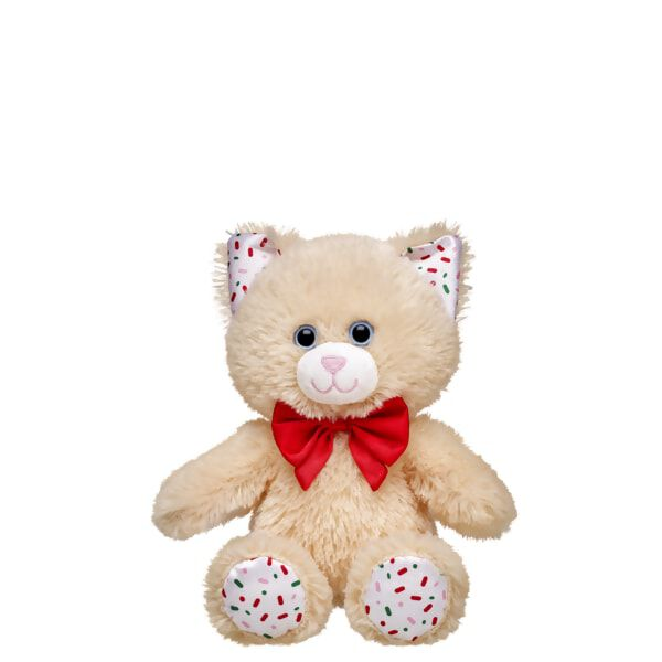 Life is sweeter with the 8-inch Build-A-Bear Buddies™ Vanilla Cookie Kitty! This adorable cream-coloured feline features a candy sprinkle design on its ears and paw pads, and a red bow tie. NOTE: This item cannot be purchased unstuffed, nor can stuffing adjustments be made. A sound or scent cannot be placed inside this pre-stuffed item. Build-A-Bear Buddies only fit in Build-A-Bear Buddies clothing.