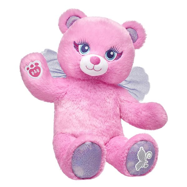 Fairy Bear is an enchanting teddy bear with bright pink plush fur, sparkly paw pads and purple fairy wings. Make your own your own fairy teddy bear online with our Bear Builder or visit a store near you.