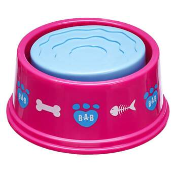 When your Promise Pets™ furry friend gets hungry and thirsty, this play food and water bowl is just the thing! The pink bowl with fun designs has a two-sided insert that lets you choose from the play food side or the play water side.