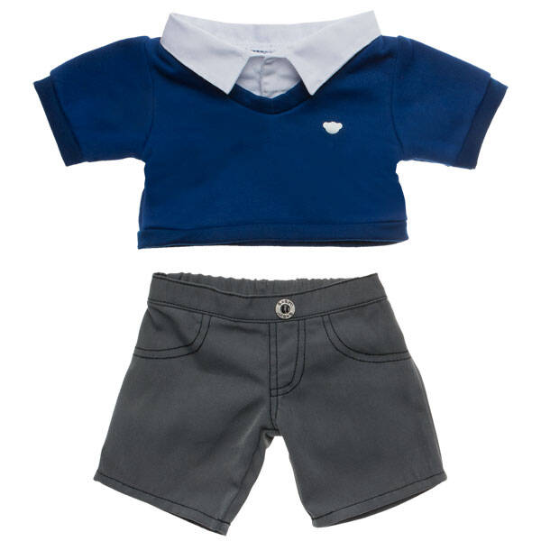 Class is in session! Your furry friend will be ready for school in this Blue & Grey School Uniform. This blue v-neck jumper has a bear head on the left chest. It's paired with a white collar and grey trousers.