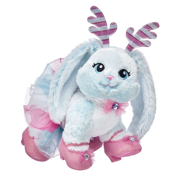 They'll hop for joy when you give them this adorable stuffed animal gift set this Christmas! Merry Mint Bunny is a friendly snowshoe rabbit who lives right outside Santa's Village, and her colourful dress and sparkly reindeer antlers add the perfect amount of glam to the season. This cheerful bunny stuffed animal is perfect for winter cuddles, so hop to it and surprise someone special!