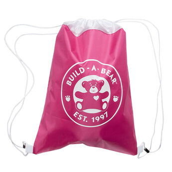 Take your furry friend with you wherever you go in this stylish fuchsia backpack! This reusable drawstring bag for stuffed animals is the perfect size for your furry friend's clothing, accessories and more at Build-A-Bear®