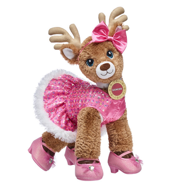 Nicknamed The Cheerful Friend, Dancer is always up for an adventure and is the perfect companion for Christmas! Let Dancer's fun personality shine through with her pink sequin dress, bow headband and pink shoes. She even comes with her reindeer medallion included. Give this complete gift set for a special touch of reindeer magic!