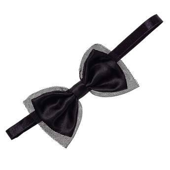 Complete your Honey Girls look with a Black Bow Headband. This stylish black satin headband features a black bow with black tulle peeking out from under it.