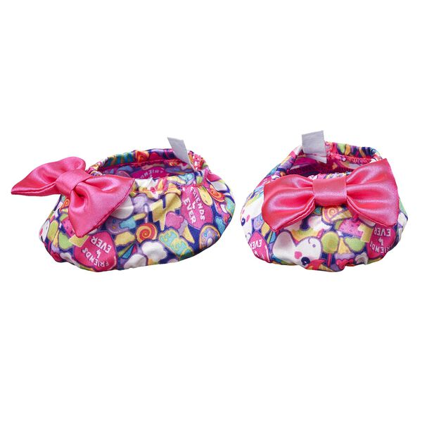 Aww! These colorful slippers are the perfect size for your furry friend's paws! They have pink bows and an all-over rainbow unicorn pattern on them. Personlize a furry friend to make the perfect gift. Shop online or visit a store near you!