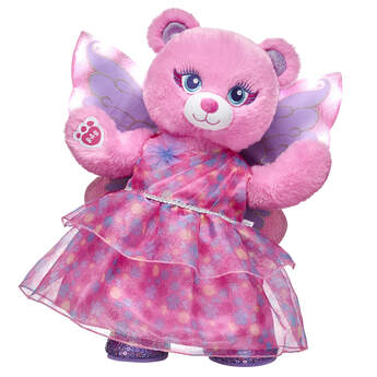 """""""Open the door to a fantasy world of fun with this enchanting gift set! This pretty-in-pink gift set features the adorable Fairy Bear is all set to spread magical fairy cheer.  <p>Price includes:</p>  <ul>     <li>Fairy Bear</li>     <li>Pink Fairy Gown </li>     <li>Light-Up Fairy Wings</li>    <li>Purple Sequin Flats</li> </ul>"""""""