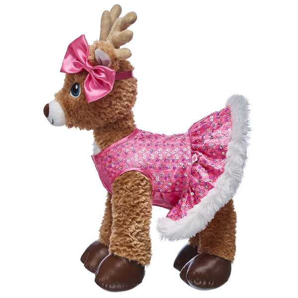 Your reindeer furry friend can light up the night sky in this bright pink dress! This beautiful dress is covered in sparkly sequins and has a white faux fur trim for extra warmth. A matching pink bow is included in the look!