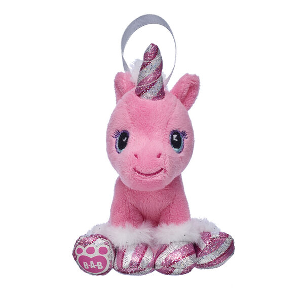 Add a little shimmer and shine to your Christmas tree with this adorable Swirl Unicorn ornament! This mini pink unicorn has a sparkly candy cane horn and glittery candy cane hooves. This limited edition ornament is a colourful way to give a cheerful Christmas gift!
