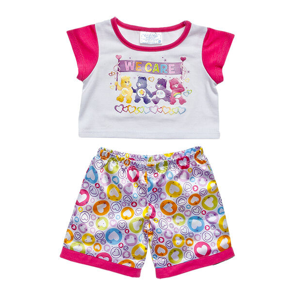 Show you care! Dress your furry friend in these Care Bears We Care PJs. The white t-shirt has fuchsia sleeves and features a Care Bears We Care graphic. The satin pants have a colourful heart pattern all over. 2015 Those Characters From Cleveland, Inc.