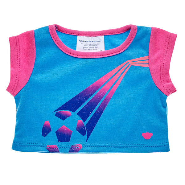 Goal! Score big with this cute T-shirt that's perfect for football fans. This blue tee has pink sleeves with a colourful football graphic on the front. Add more football outfits and accessories to any furry friend to make a perfect gift for sports fans!