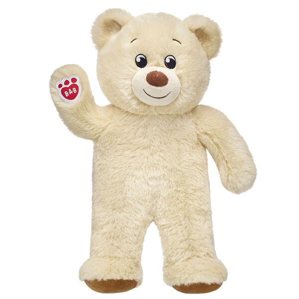 creme coloured teddy bear standing and waiving