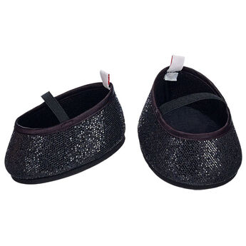 Ooh la la! Add a bit of sparkle to any outfit with a pair of Black Sparkle Flats. These black flats feature a touch of sparkle for a fancy look.