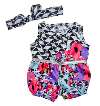 Your furry friend will be ready to bust a move in Honey Girl Misha's floral romper! This fun romper features a floral pattern mixed with a geometric pattern and is finished off with a sparkly silver belt. Plus, it includes a matching headband.
