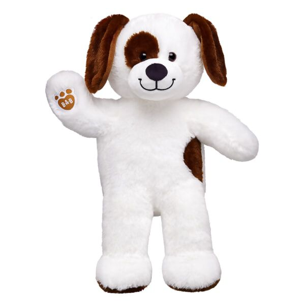brown and white coloured dog plush standing