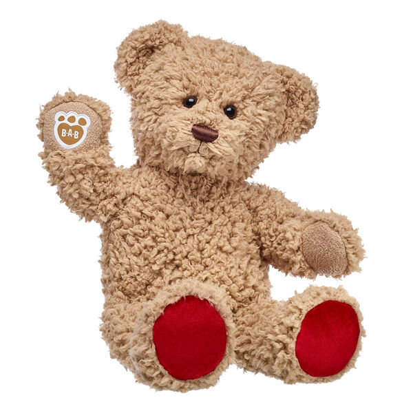 Teddy bears are a timeless way to share love with every hug! Timeless Teddy is a classic furry friend with shaggy brown fur and an adorable smile. This teddy bear's paw pads are bright red for a nice pop of colour. Personalise Timeless Teddy with outfits, sounds and accessories for a huggable gift they'll cherish forever!