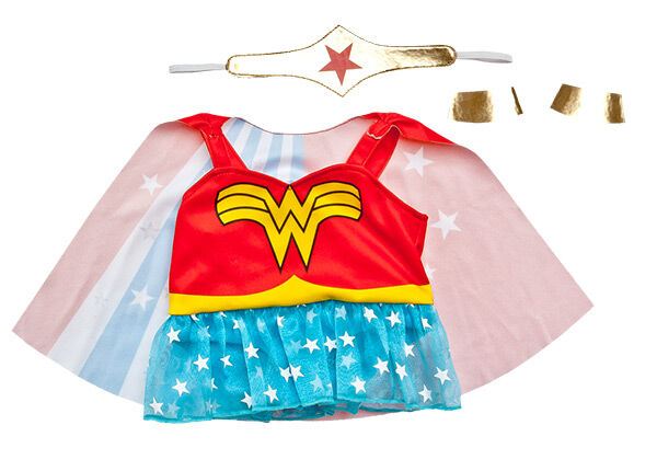 "Hera, give me strength! Transform any furry friend into Wonder Woman with the classic costume that includes a red dress with  a ""W"" on it, yellow belt, and blue skirt with white stars. The attached red, white and blue cape has stars and stripes on it. Plus, it includes Wonder Woman's bracelets and tiara. Save the day together! WONDER WOMAN and all related characters and elements  & ™ DC Comics."