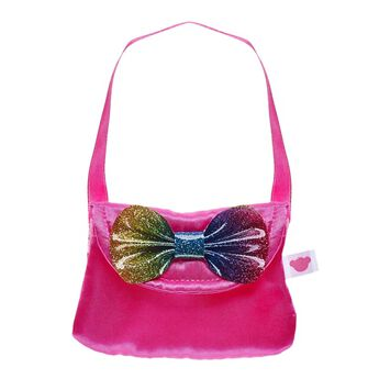 Light up your furry friend's look with this colourful purse that has just the right amount of sparkle! This bright pink handbag has a glittery rainbow bow that provides a perfect bit of flair to any furry friend's outfit.