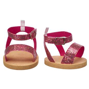 These teddy-bear sized Pink Sparkle Sandals add a perfect pop of colour to any look! Build-A-Bear Workshop offers hundreds of unique stuffed animal clothing & accessory options you won't find anywhere else. Outfit a furry friend online to make the perfect gift!