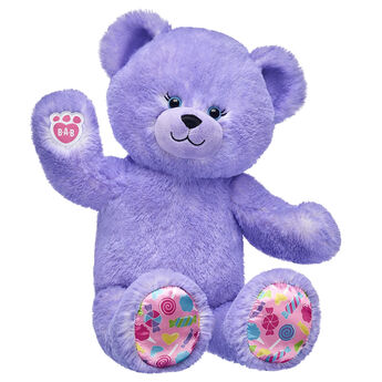 purple candy pop teddy bear sitting