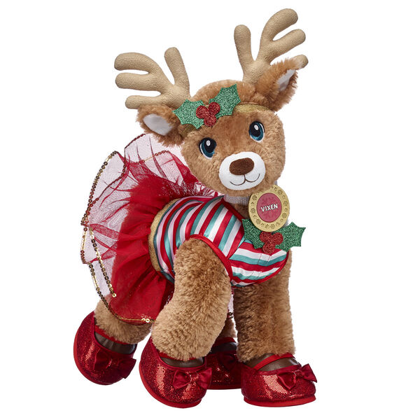 There's a reason Vixen is nicknamed The Swift and Sporty Deer - she's known for being fast, smart and sweet!  This complete reindeer stuffed animal gift set includes her festive holly dress and matching headband. Her sparkly red flats feature a touch of glimmer for a perfectly fancy look!