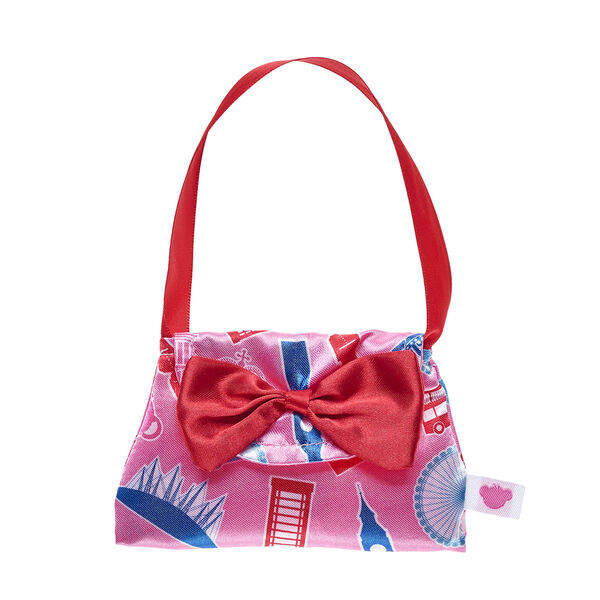 Celebrate all the iconic parts of London while you're out exploring with your furry friend! This bear-sized pink purse has an all-over pattern of multiple British icons, including double-decker buses, Big Ben, telephone booths and the London Eye.