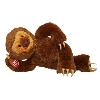 sloth stuffed toy laying down