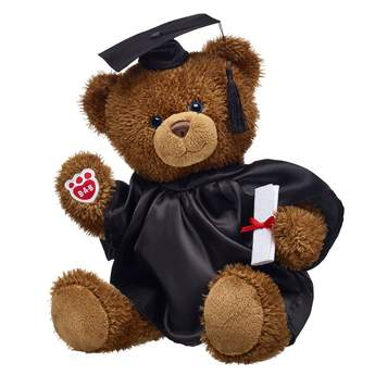 """""""Here's a graduation gift set that's as bright as their future! When it comes to adorable school spirit, this cuddly gift set definitely makes the grade. Traditional Cocoa Bear is ready to celeBEARate a job well done in its black graduation outfit! <p>Price includes:</p>  <ul>    <li>Traditional Cocoa Bear</li>     <li>Black Graduation Set 4 pc.</li> </ul>"""""""