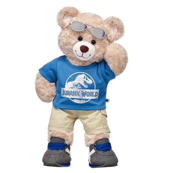 """Happy Hugs Teddy is ready to explore the park! This cool stuffed animal gift set features this adorable teddy bear in a Jurassic World T-shirt. It's a dino-mite gift idea for movie fans! Jurassic World is a trademark and copyright of Universal Studios and Amblin Entertainment, Inc. Licensed by Universal Studios. All Rights Reserved.  <p>Price includes:</p>  <ul>    <li>Happy Hugs Teddy</li>     <li>Jurassic World T-Shirt </li>    <li>Tiny Pocket Khaki Shorts</li>    <li>Gray & Blue Athletic Shoes</li>    <li>Aviator Sunglasses</li> </ul>"""