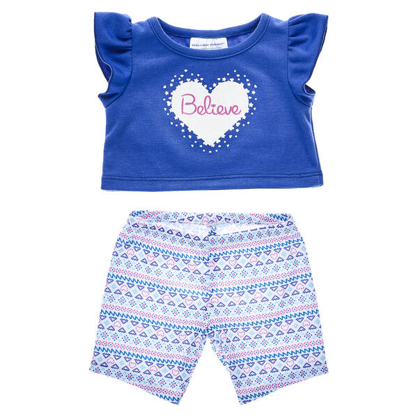 There's a special magic in believing during the Christmas season! This adorable two-piece outfit includes a blue tee and a festive pair of colourful leggings.