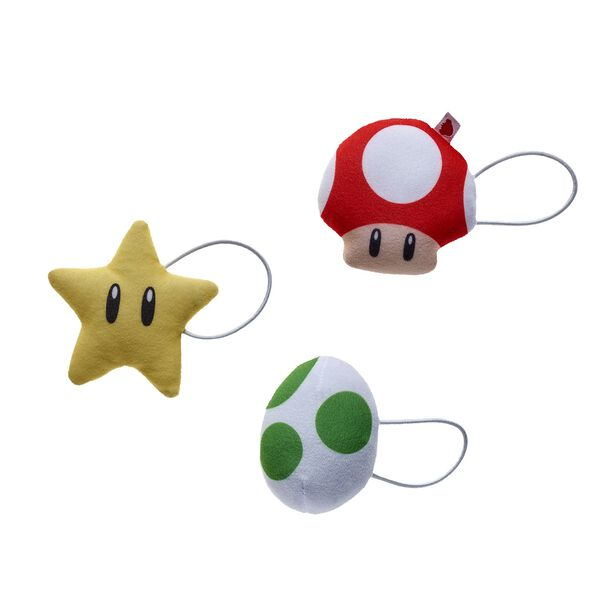 Power up your furry friend's accessories by adding this awesome three-piece set to your collection! This plush wrist accessory set comes with Yoshi's Egg, a Super Star and a Super Mushroom. ™ & © 2017 Nintendo.