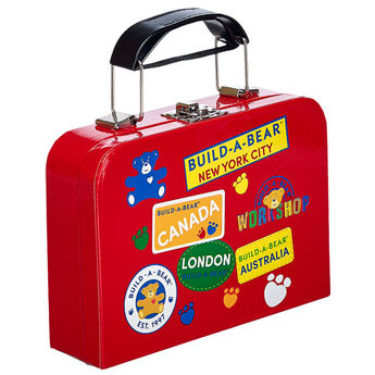 Your furry friend will be traveling in style with this fun red toy suitcase. It's the perfect accessory for your on-the-go friend!