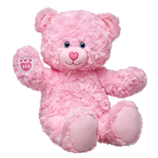 Pink Cuddles Teddy Bear is a soft and sweet furry friend. This pink teddy bear has swirly fur and an adorable heart-shaped nosed with light blue eyes.