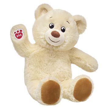cream coloured teddy bear sitting