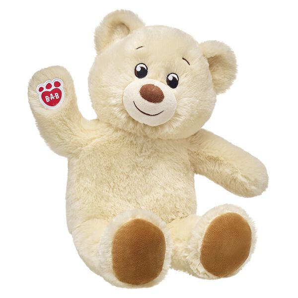 cream coloured teddy bear sitting