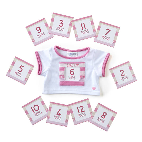 Let baby's furry friend count how fast they're growing! This cute bear-sized pink T-shirt has a special slot on the front to insert monthly milestone cards. It's the perfect addition to those must-have baby photos! Note: Little Cub Hugs items are only available online and in select stores.